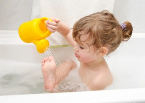 Child is playing in a bath